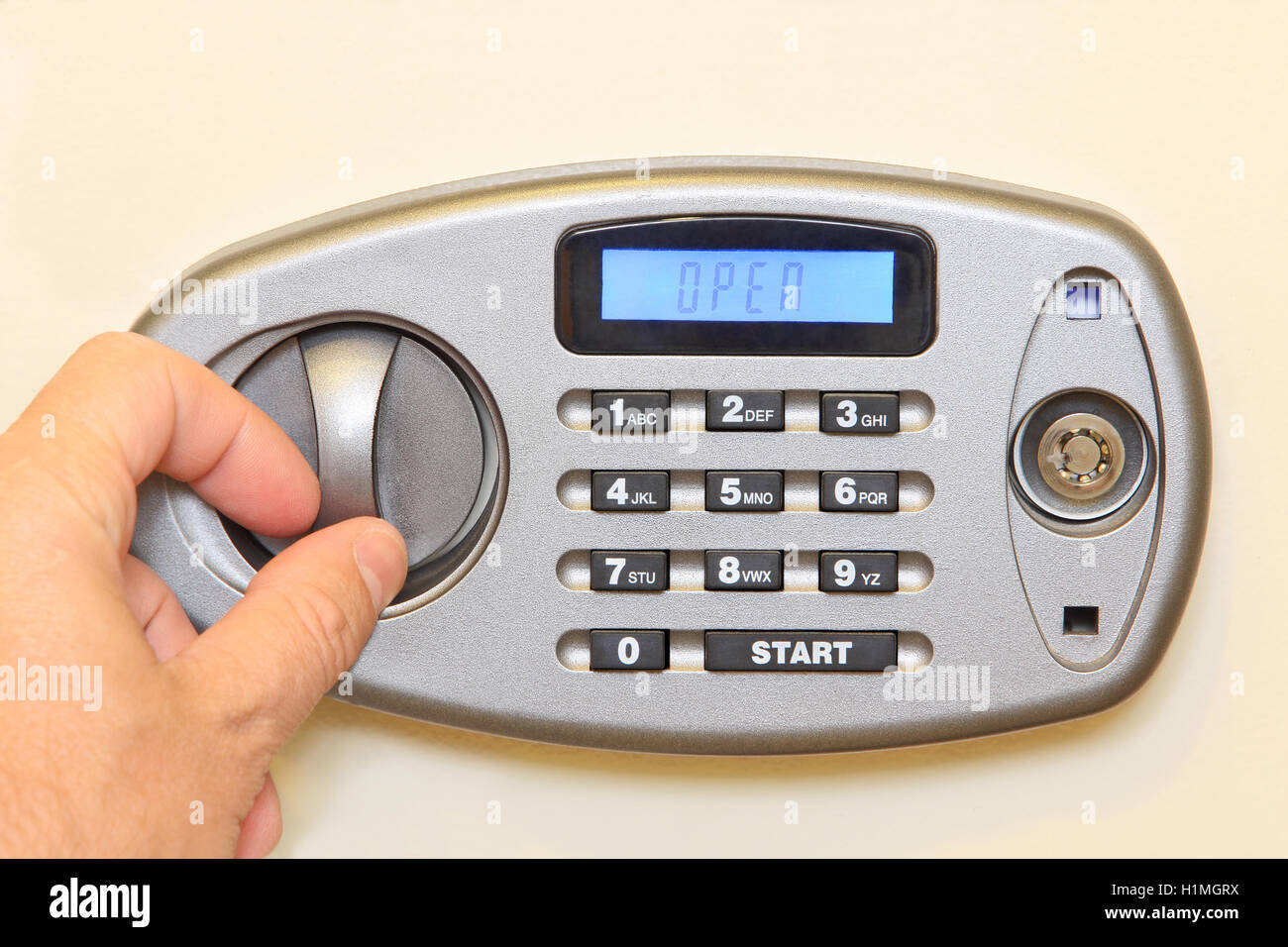 Man hand open of electronic home safe.Closeup. - Stock Image