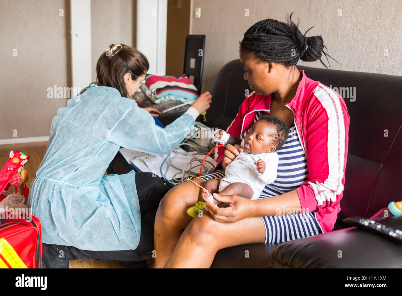 Nurse home visit from a baby born premature, Home medical care department of Limoges hospital, France. - Stock Image