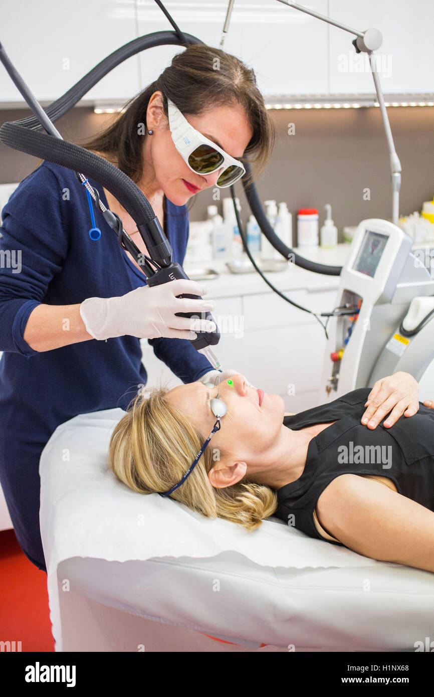 Vascular laser used in treatment of rosacea and varicosity Stock Photo