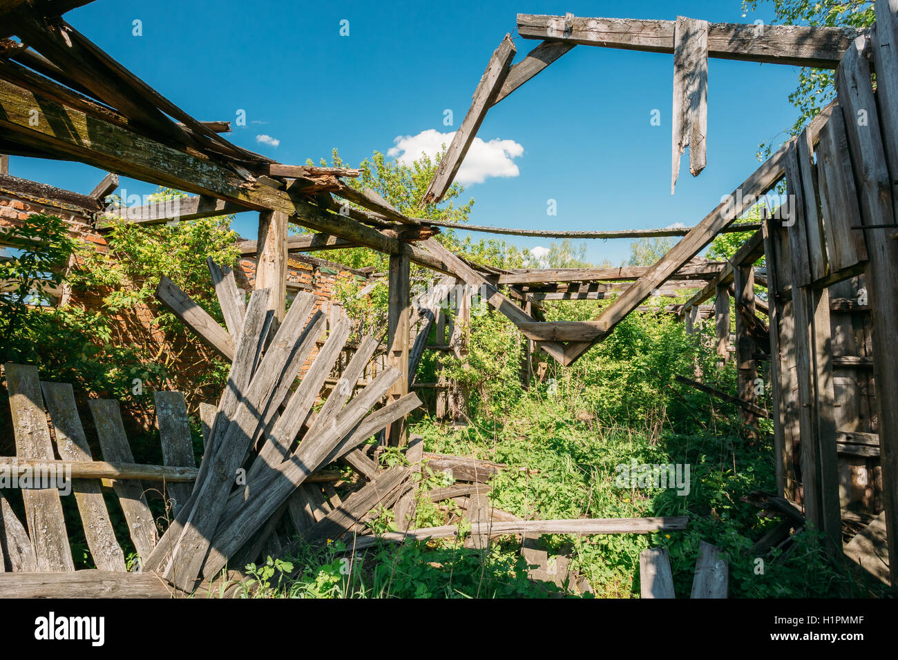 Close The Wooden Ruins Of  Abandoned House After Chernobyl Tragedy In Evacuated Countyside. Terrible Consequences - Stock Image