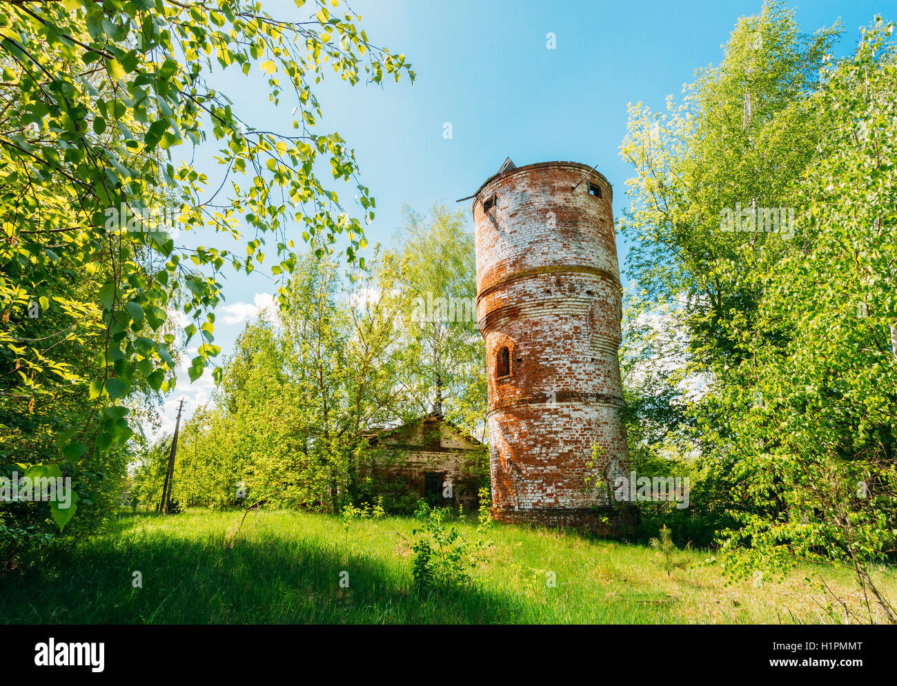 The Abandoned Brick Water Tower In Evacuated Zone After Chernobyl Catastrophe, Against The Background Of Scenic - Stock Image