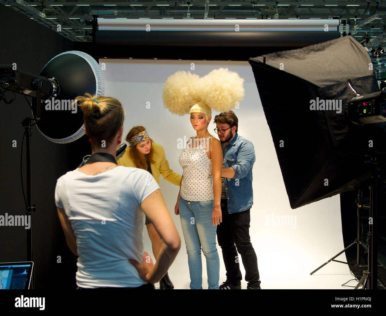 Creative team working on a fashion shoot in the photo studio, Cologne, Germany - Stock Image