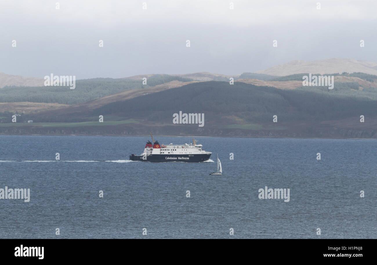 Calmac ferry MV Finlaggan passing yacht Scotland  September 2016 Stock Photo