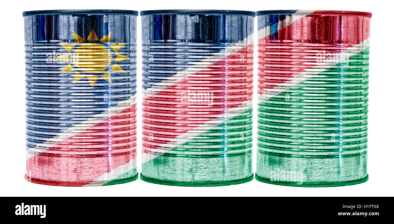 Three tin cans with the flag of Namibia on them isolated on a white background. - Stock Image