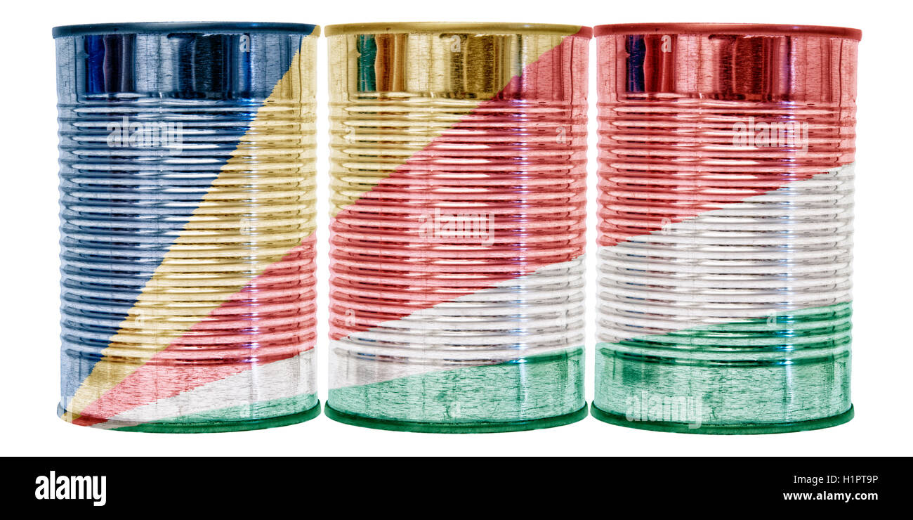 Three tin cans with the flag of Seychelles on them isolated on a white background. - Stock Image