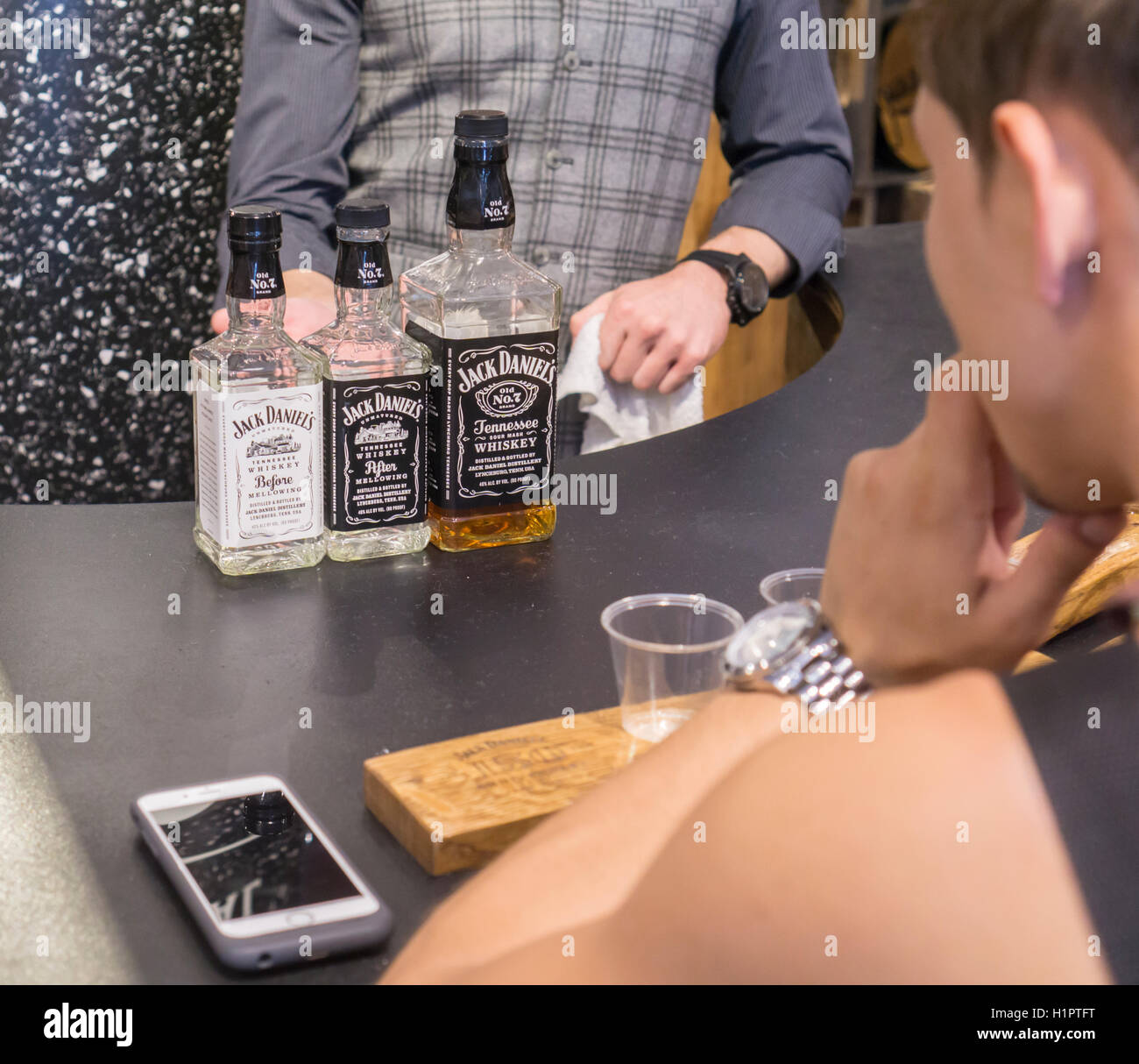 Visitors taste samples at the Jack Daniel's Lynchburg General Store pop up branding event in New York on Tuesday, Stock Photo