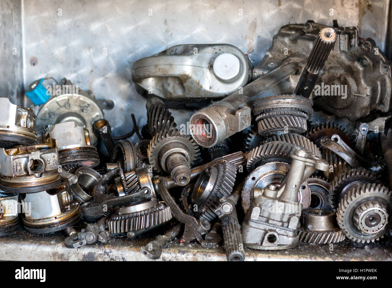 on the shelf are out of order old car engine parts Stock Photo ...