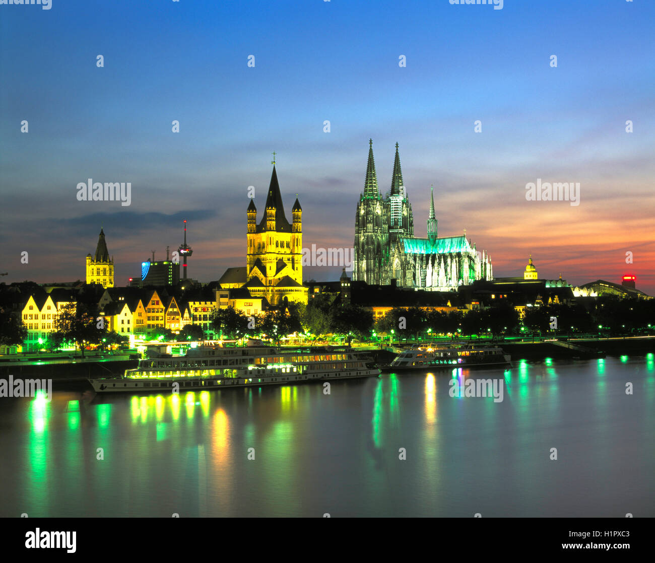 Cologne skyline and River Rhine at dusk, North Rhine Westphalia, Germany - Stock Image