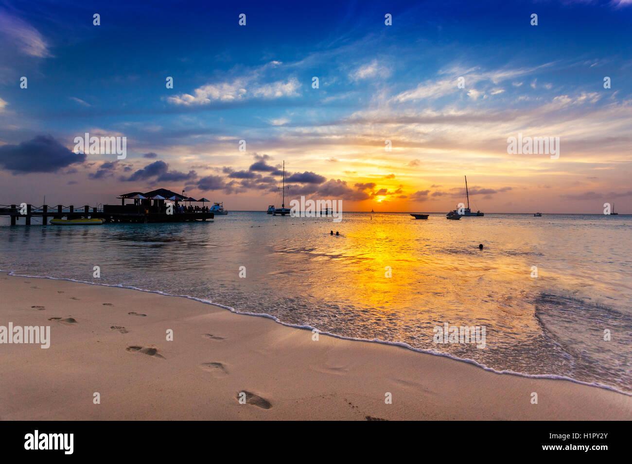 Sun goes down over Palm Beach, Aruba - Stock Image