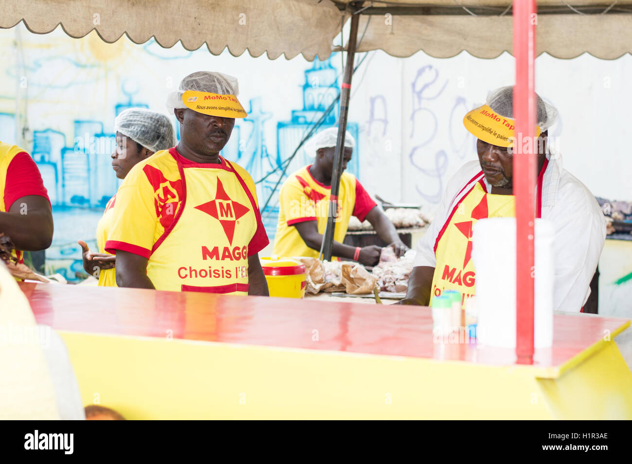 Abidjan, Ivory Coast, September 11 2016: barbecue festival in Abidjan with  people dressed in  red and yellow. - Stock Image