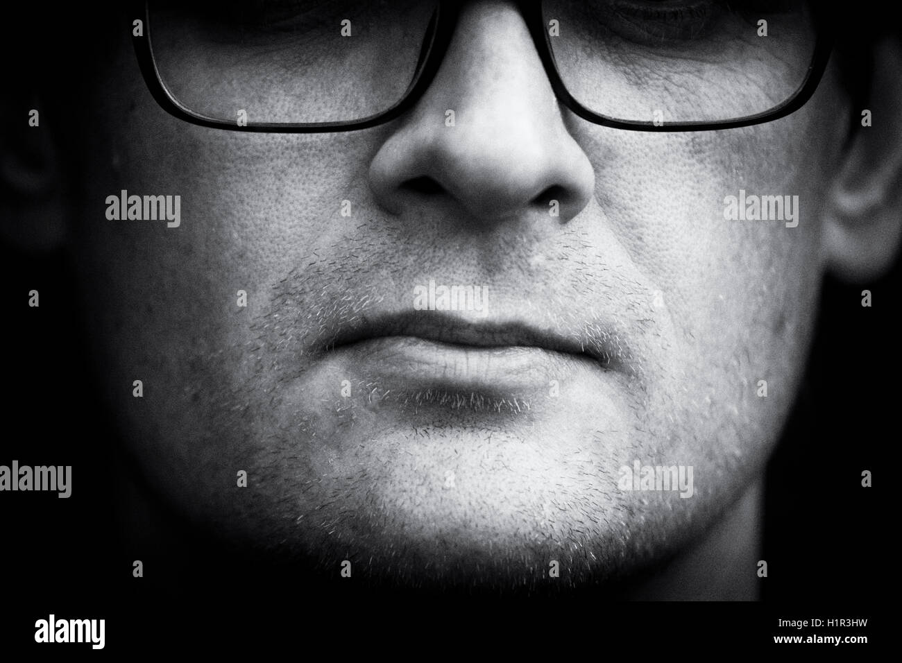 450b9ffbb6b0 portrait of a man with glasses and eyes not visible in black and white