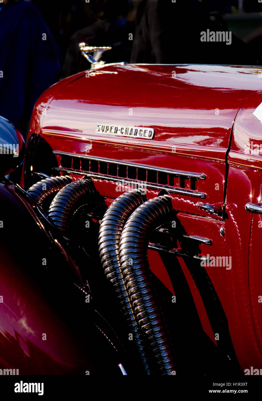 External exhaust pipes of a 1935 Auburn 851 Speedster - Stock Image