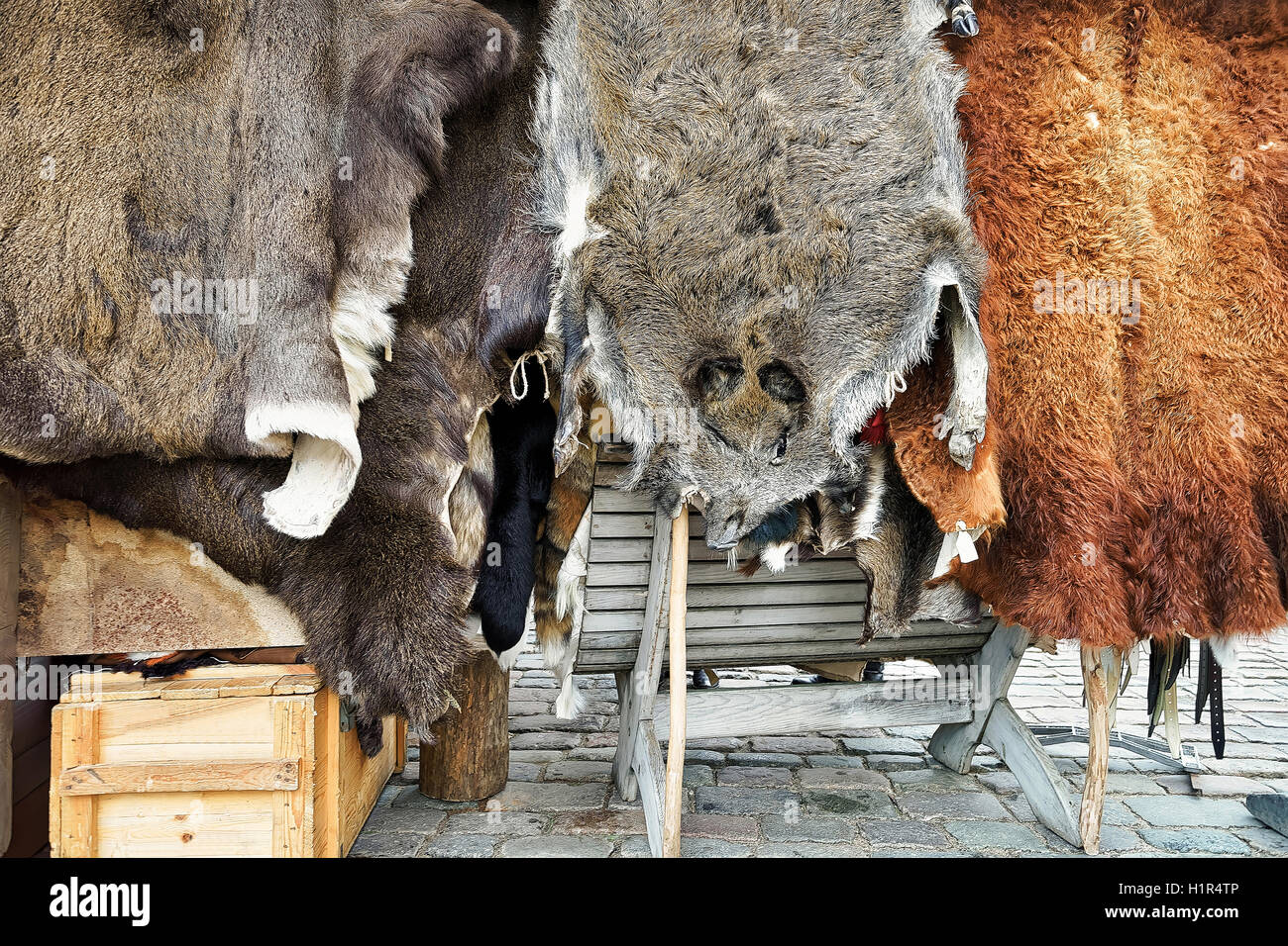 Animal skin on the display on sale at the Christmas Market in Riga, Latvia. The market is full of various goods, - Stock Image