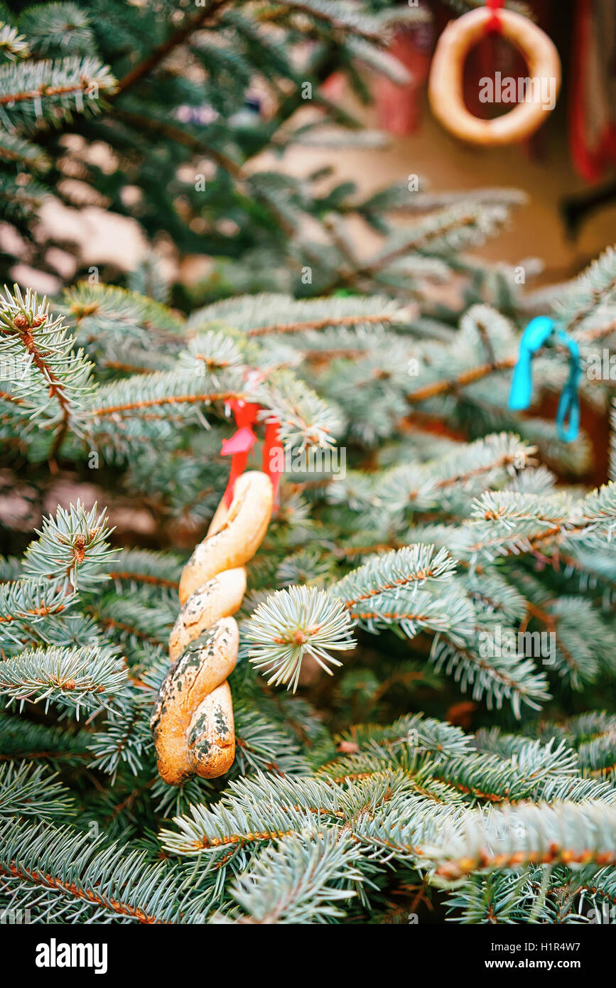Christmas tree decorated with cookies at the streets of Riga in Latvia. The Christmas tree is one of the main symbols Stock Photo