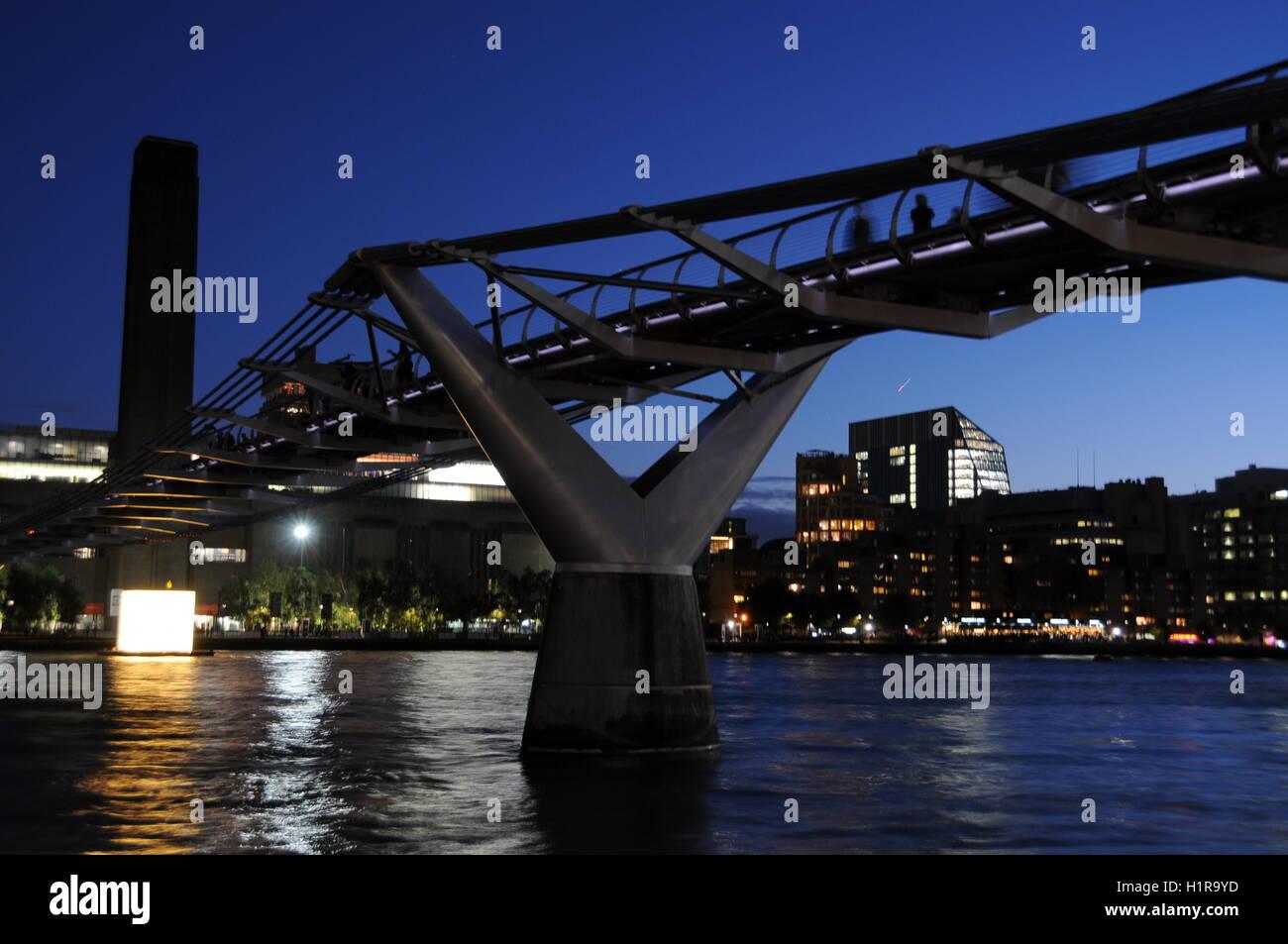 A horizontal image of London's Millennium Bridge, at night. - Stock Image