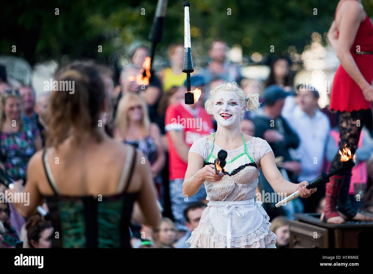 Fire juggling act from Le Cirque du Platzak at Great Yarmouth's Out There Festival in 2015. - Stock Image