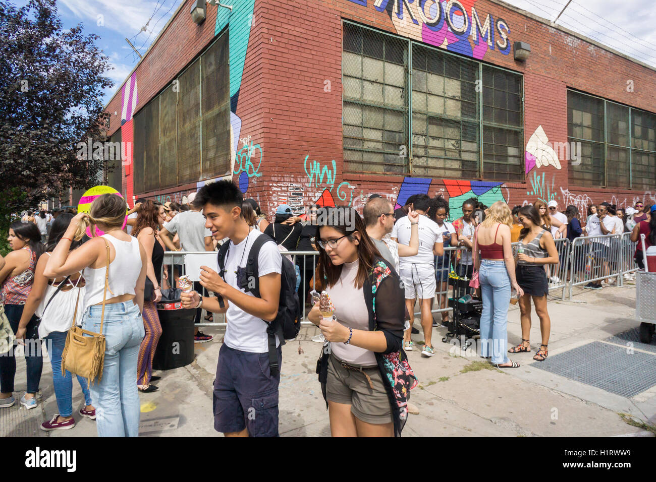 Thousands of millennials descend on the Bushwick neighborhood of Brooklyn to take in the experiential 29 Rooms installation on Sunday, September 11, 2016. The exhibit by the women's lifestyle website Refinery29 is a social media spectacle with art and culture themed rooms designed with selfies in mind. The installation was wildly popular, in part due to the social media aspect, so popular that the line was cut off at noon, hours before the last entry. (© Richard B. Levine) Stock Photo