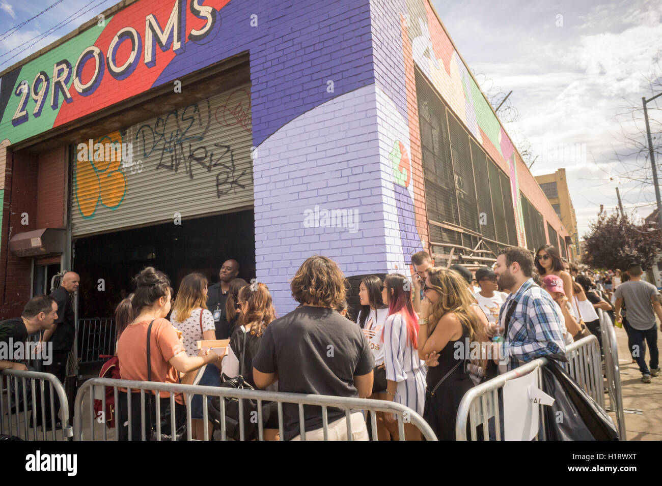 Thousands of millennials descend on the Bushwick neighborhood of Brooklyn to take in the experiential 29 Rooms installation Stock Photo
