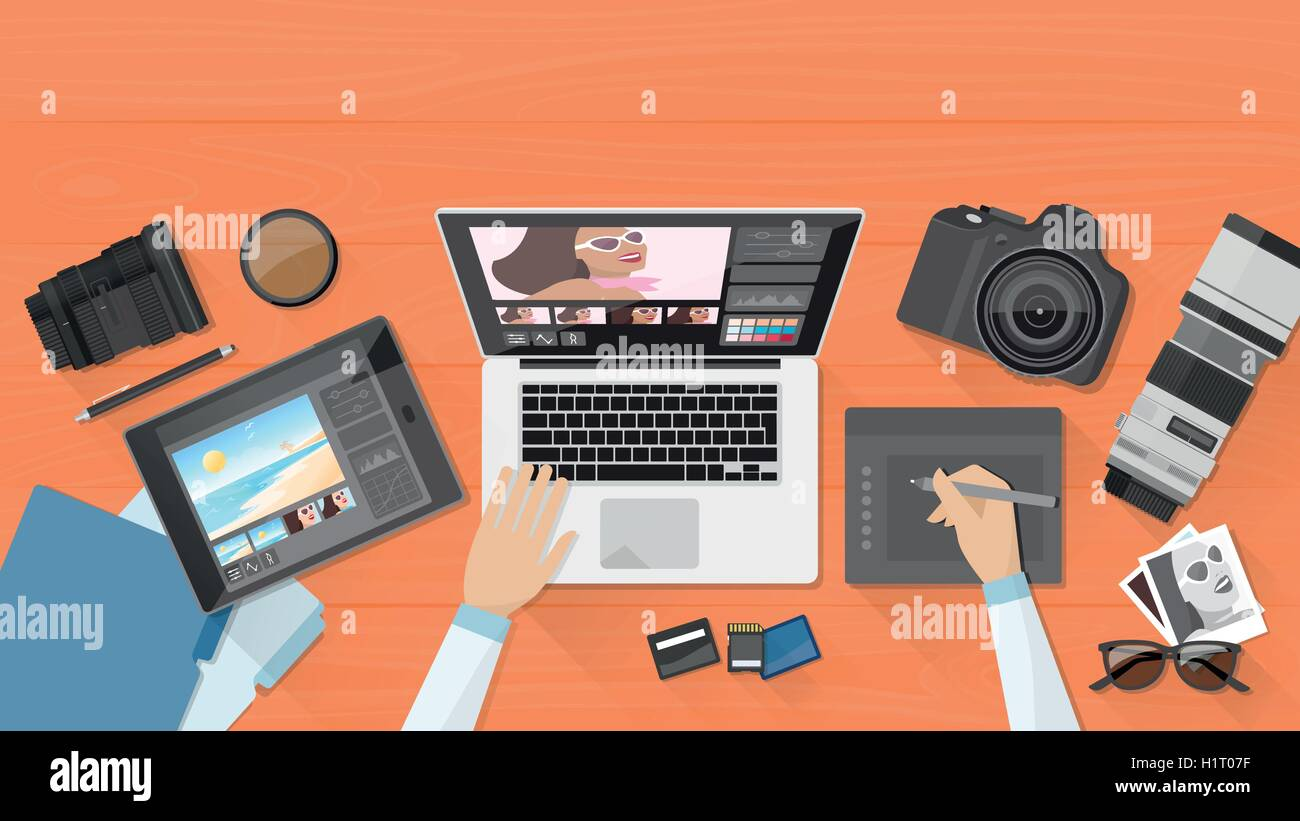 Professional photographer working at office desk, he is editing his pictures using a laptop and a graphic tablet - Stock Vector