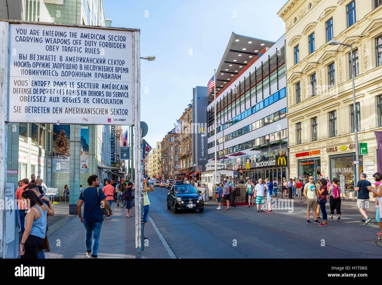 Tourists at the site of Checkpoint Charlie, Berlin, Germany - Stock Image