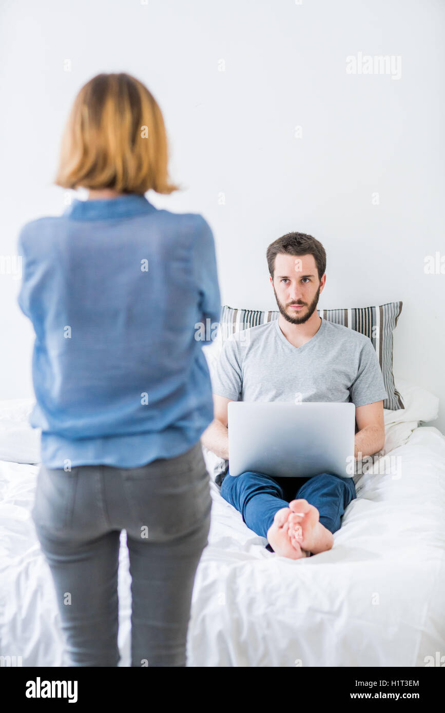 Couple with laptop computer arguing. - Stock Image