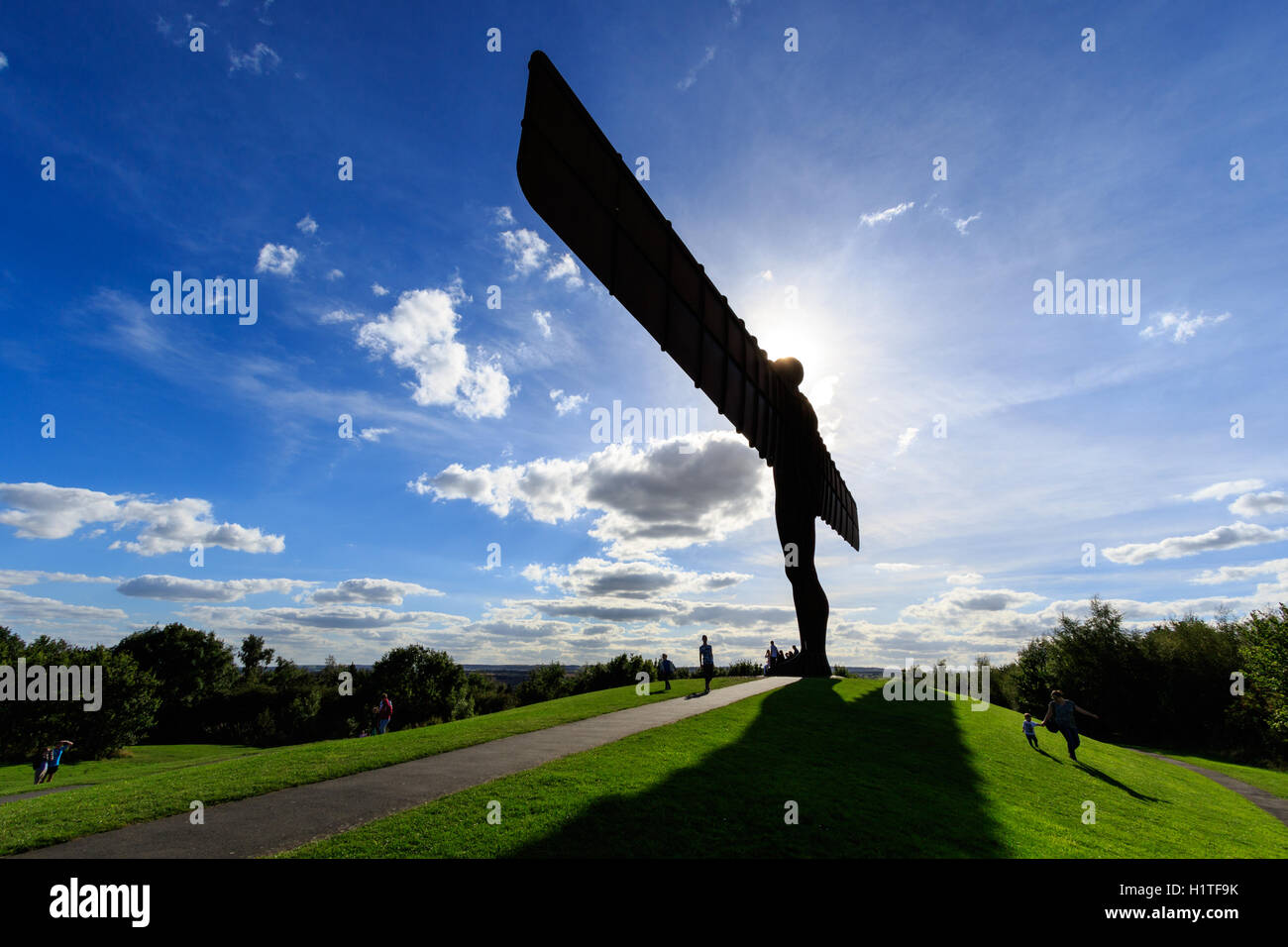 View of the Angel of the North statue with blue sky and white clouds. - Stock Image