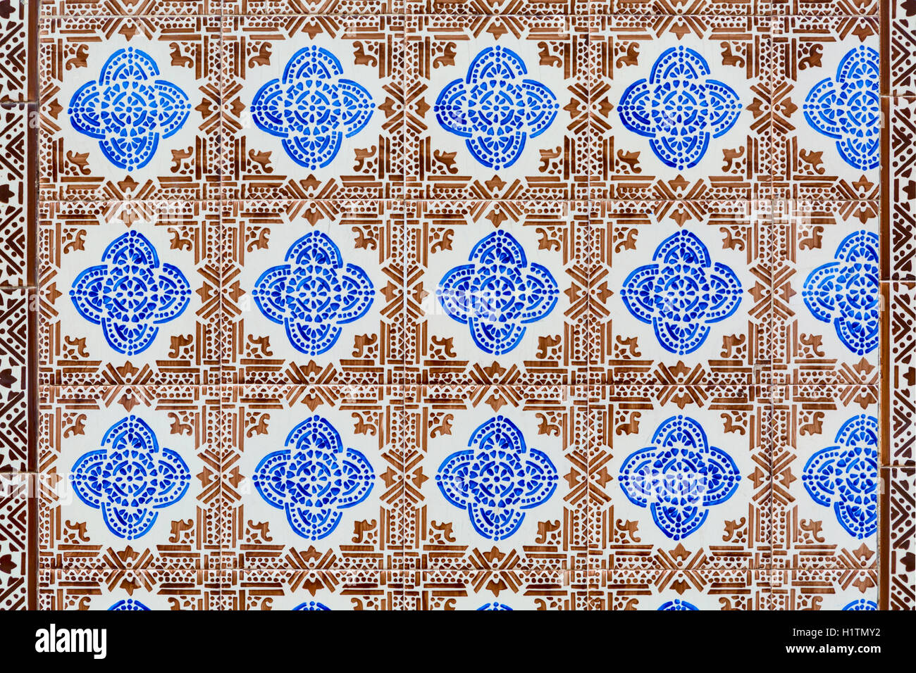 old brown and blue colored azulejos - hand painted tiles from Lisbon - Stock Image