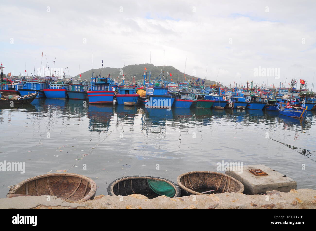 Nha Trang, Vietnam – February 21, 2013: Many fishing boat are parking at the Hon Ro seaport in Nha Trang city Stock Photo