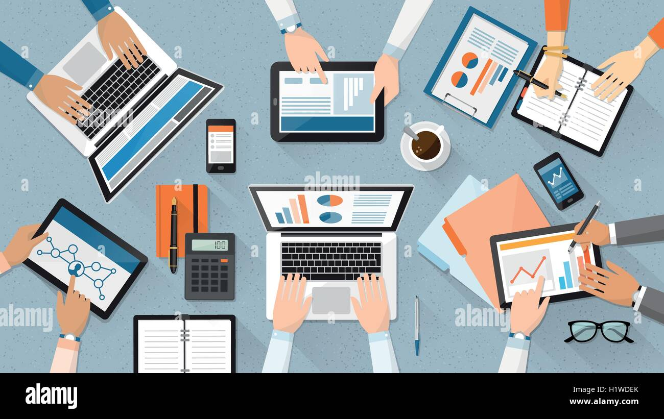 Business team working together at office desk, they are using laptops and checking financial reports, corporate - Stock Image
