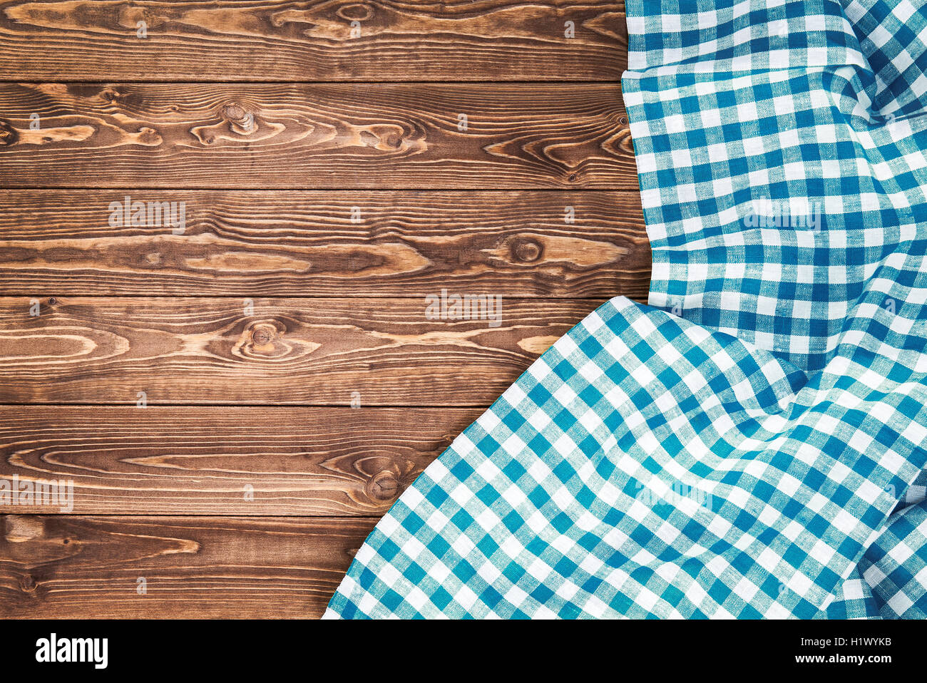 Blue Checkered Tablecloth On Wooden Table