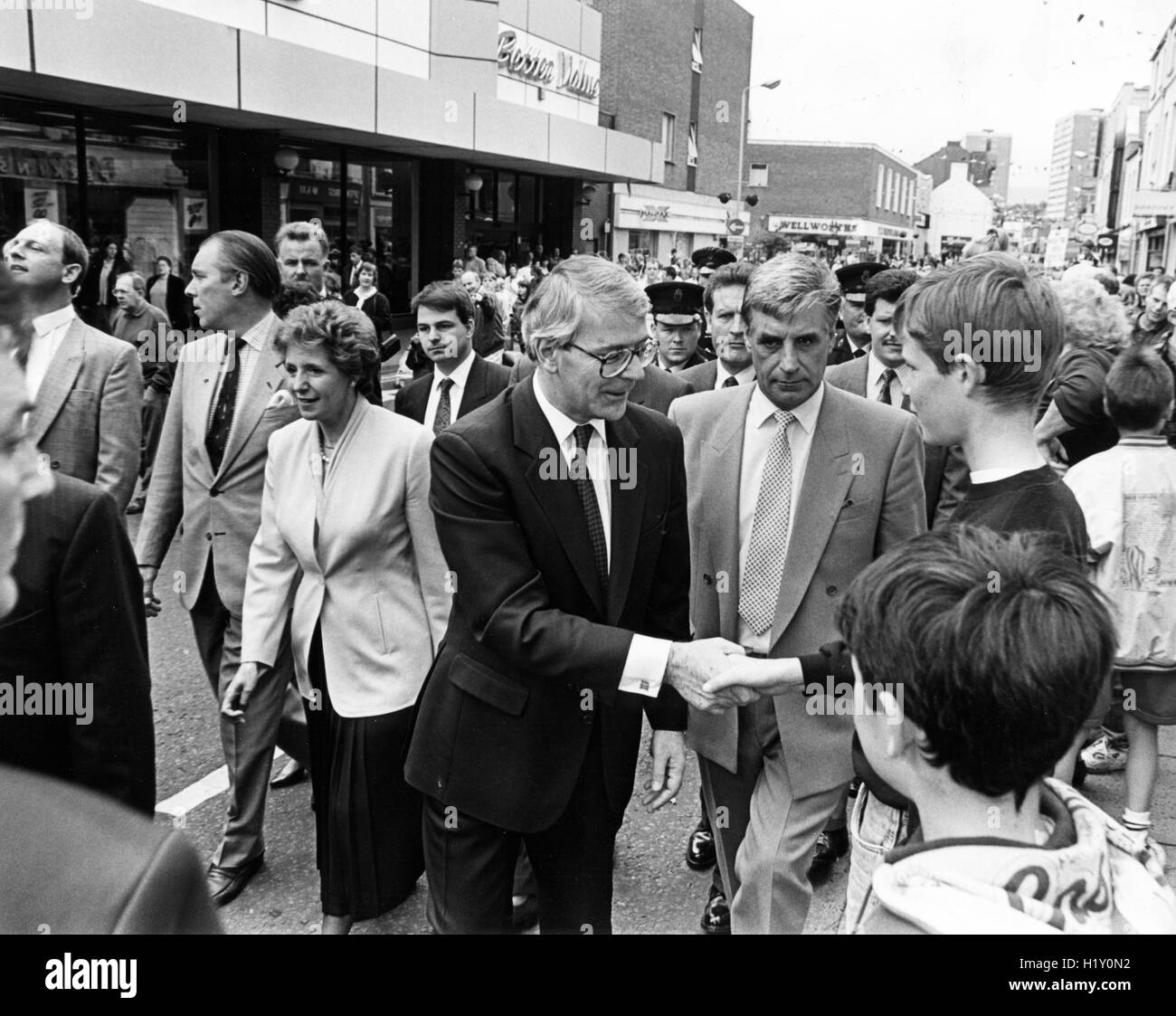 John Major during a walk about in Larne, Northern Ireland, is a British politician who was the Prime Minister of - Stock Image