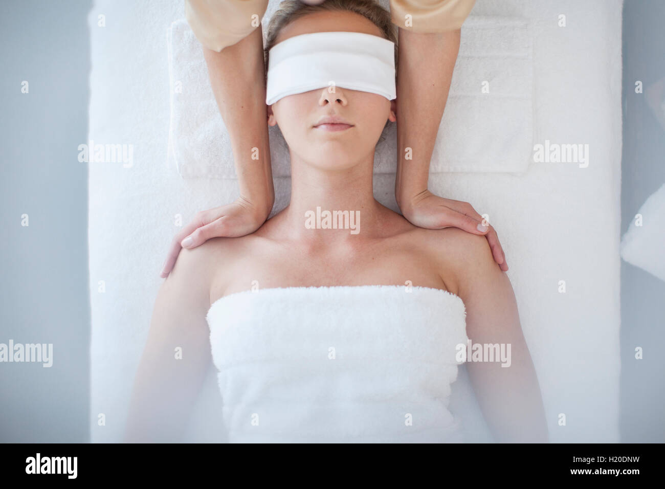 Young Woman Lying On Massage Table Receiving Beauty Treatment Stock Image