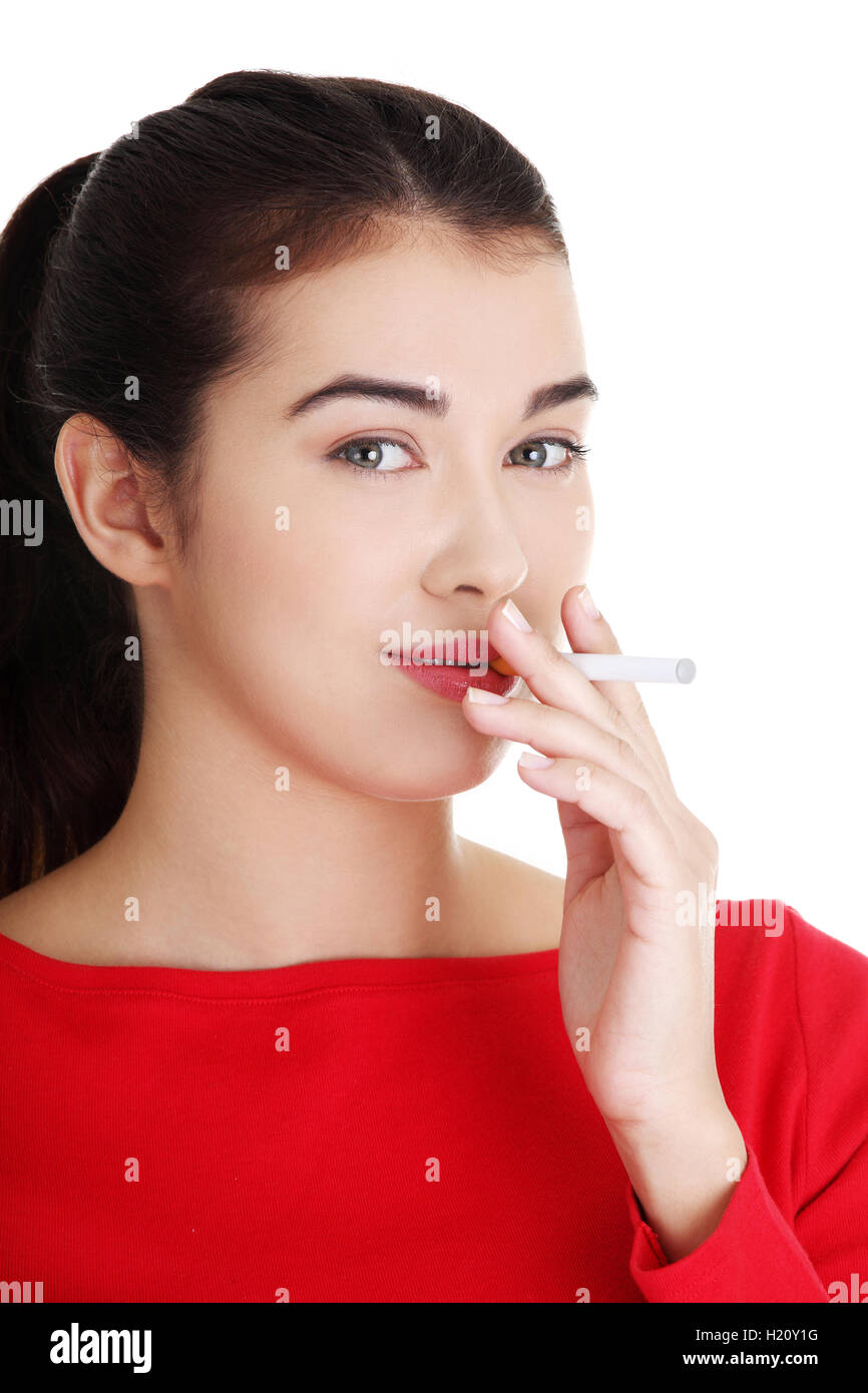 Young woman smoking electronic cigarette - Stock Image
