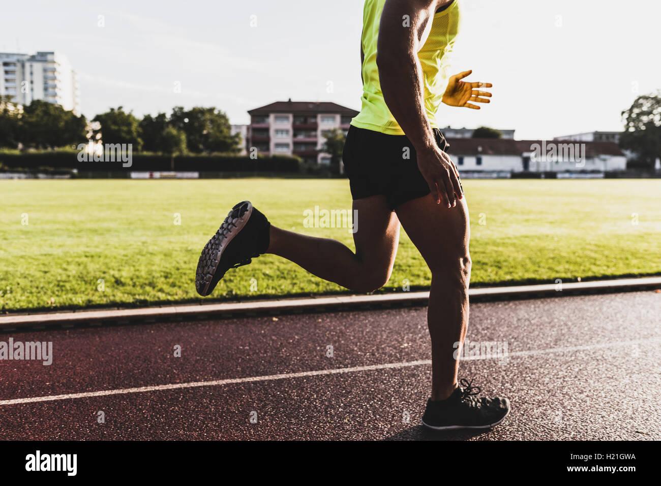 Athlete running on tartan track Stock Photo