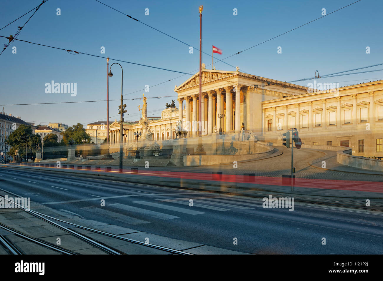 Austria, Vienna, Austrian Parliament, Light trail of tram - Stock Image