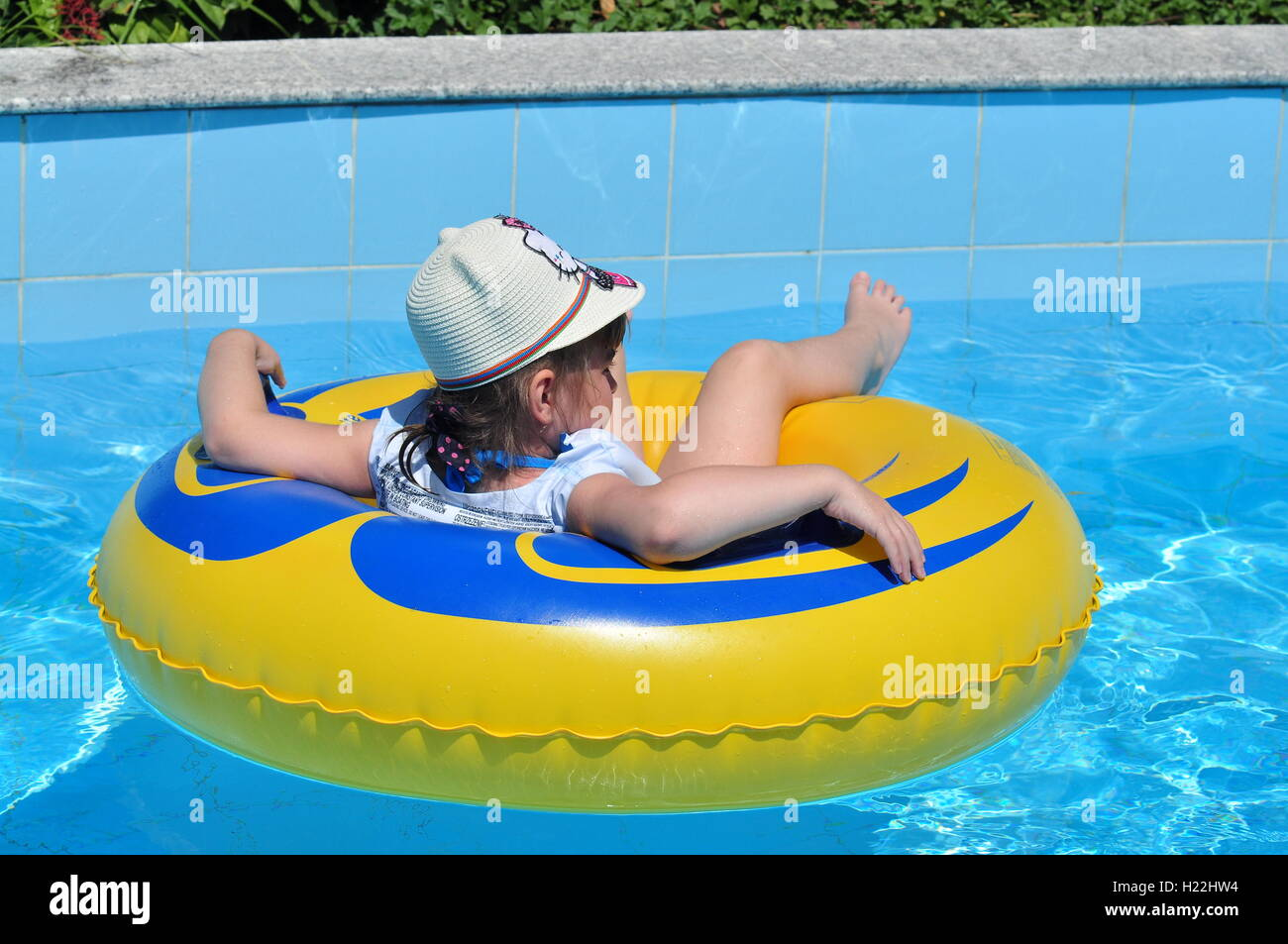 Nha Trang, Vietnam - October 30, 2015: A little girl is swimming in the waterpark of the Vinpearl Land - Stock Image