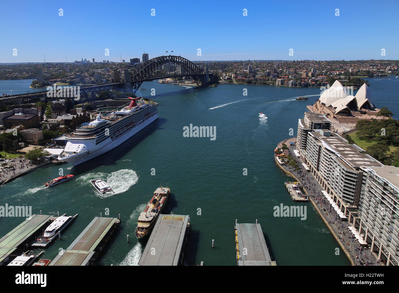 Aerial view of ferries departing from Circular Quay and Cruise Ship berthed at Overseas Passenger Terminal Sydney Stock Photo