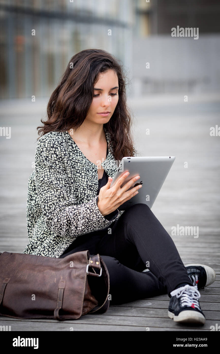 Woman using digital tablet. - Stock Image