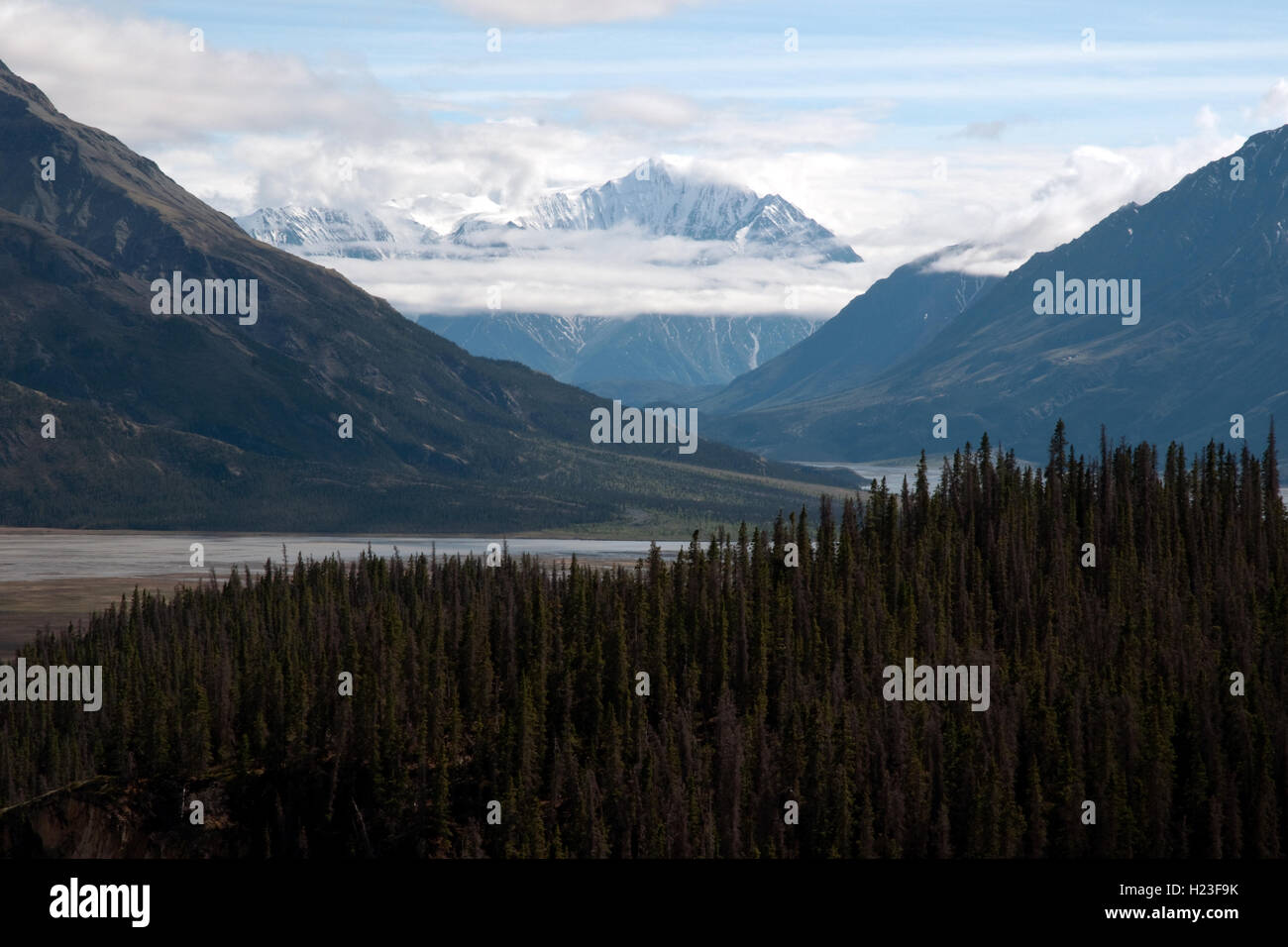 A peak at the high ranges and ice fields of the St. Elias Mountains at the head of the Slims River Valley, Yukon, - Stock Image