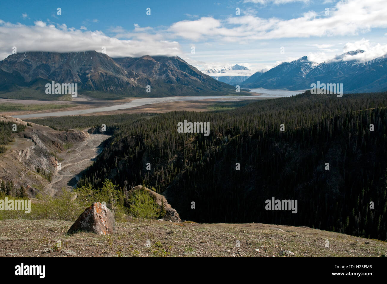 A view of the misty St. Elias Mountains and the Slims River Valley in Kluane National Park, Yukon Territory, Canada. - Stock Image