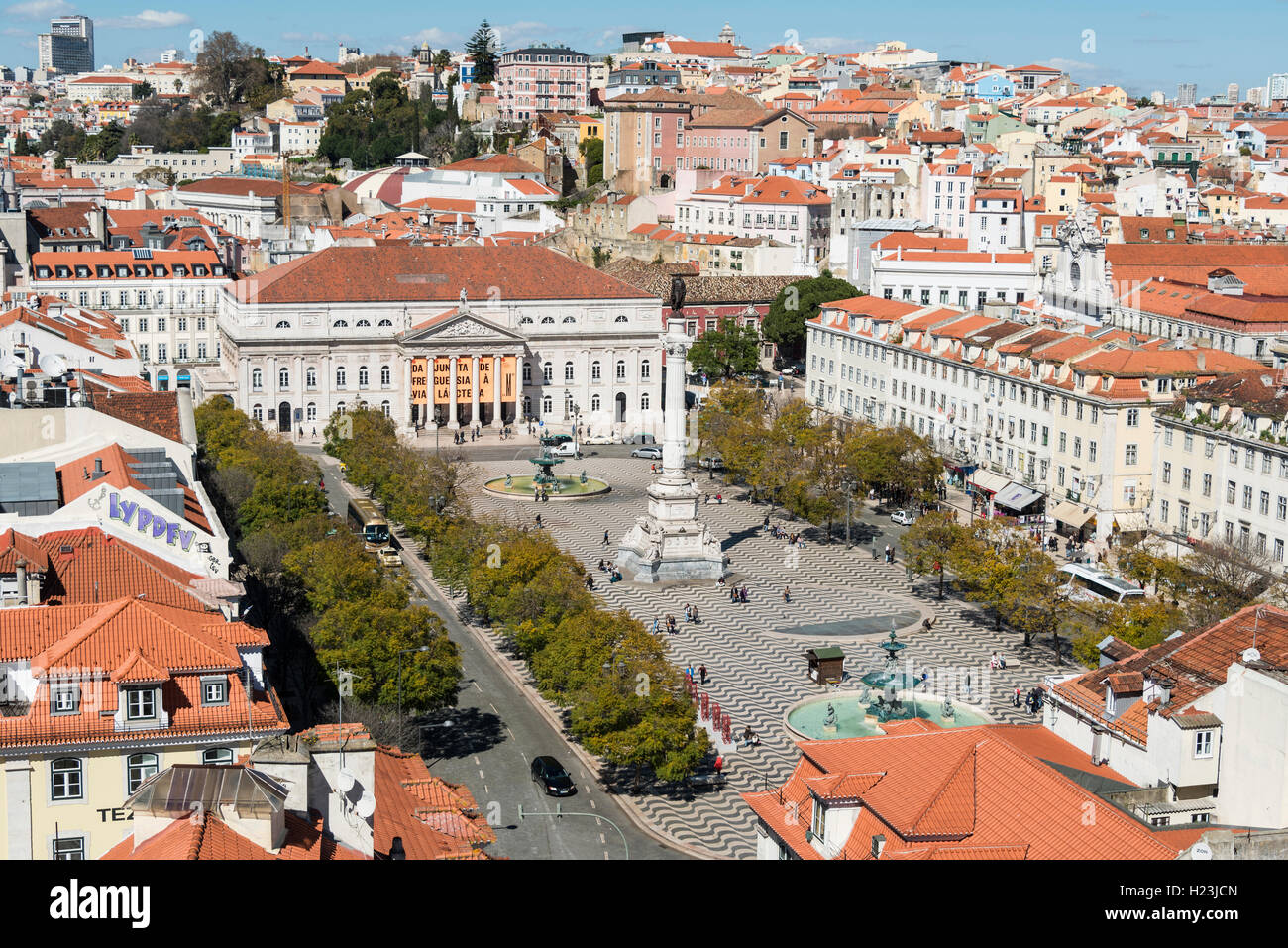 View of historic centre, statue of King Pedro IV in Rossio Square, National Theatre, Baixa, Lisbon, Portugal - Stock Image