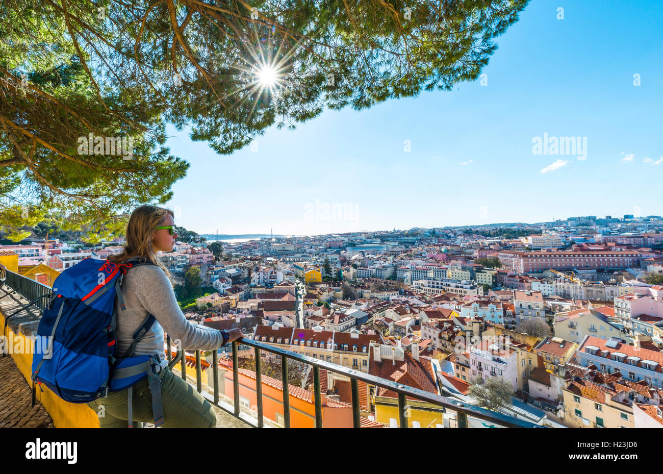 Woman looking at city, Graça viewpoint, Lisbon, Portugal - Stock Image