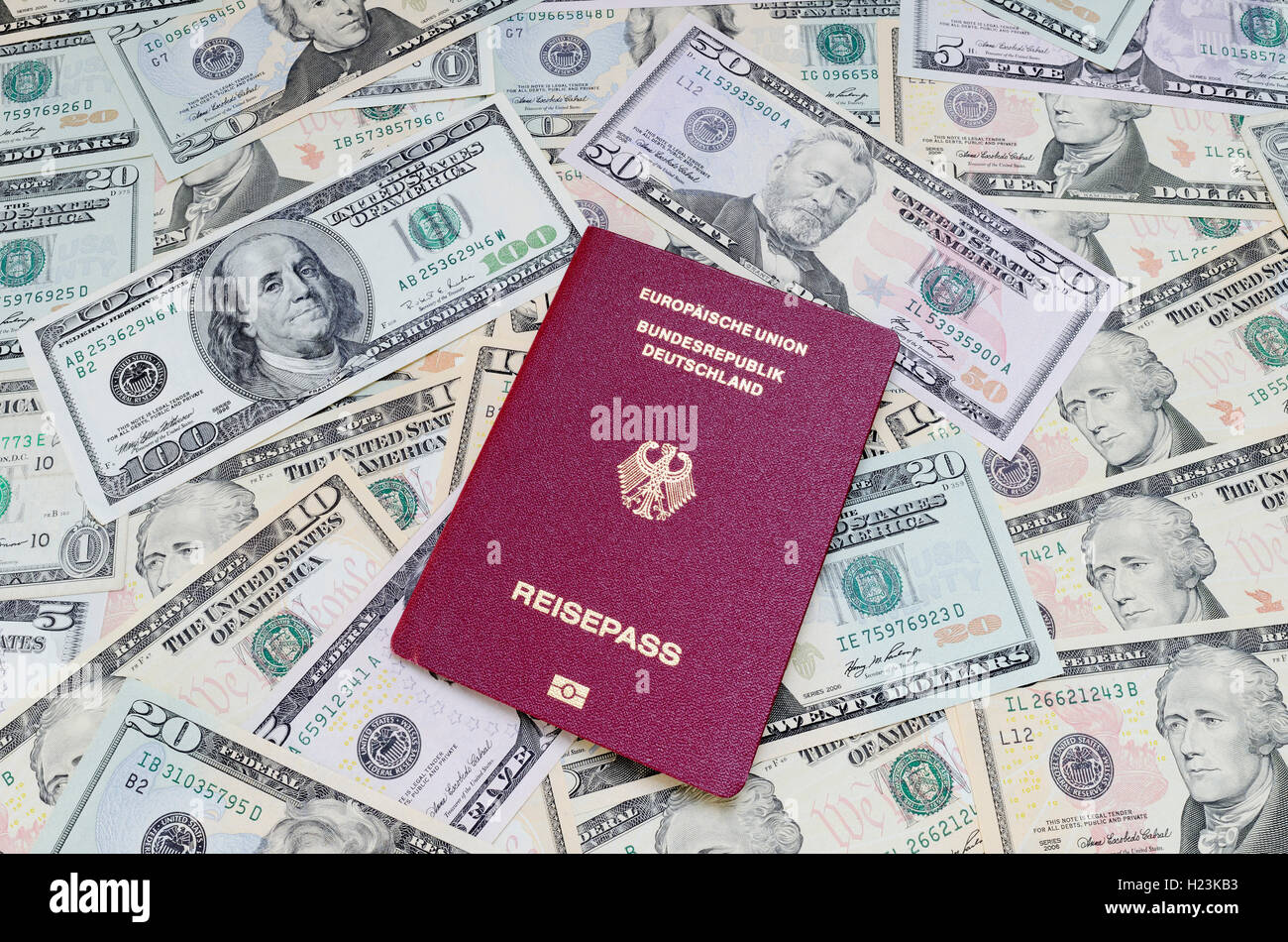 German passport and US dollar bills - Stock Image