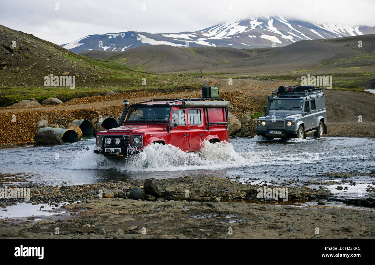 Cars crossing ford, Gygjarfoss, Vysočina Region, Iceland - Stock Image