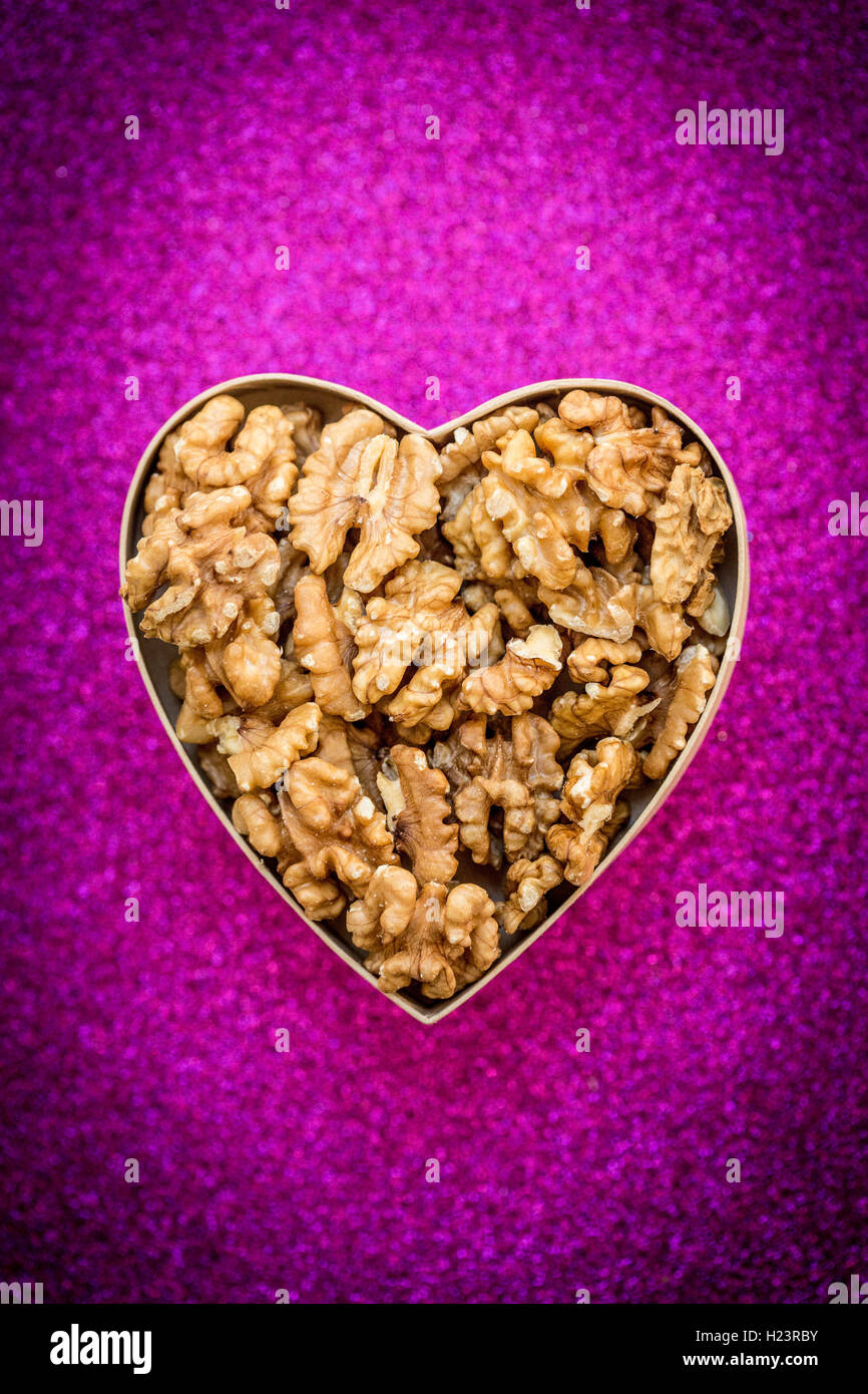 Walnuts in heart shape. - Stock Image