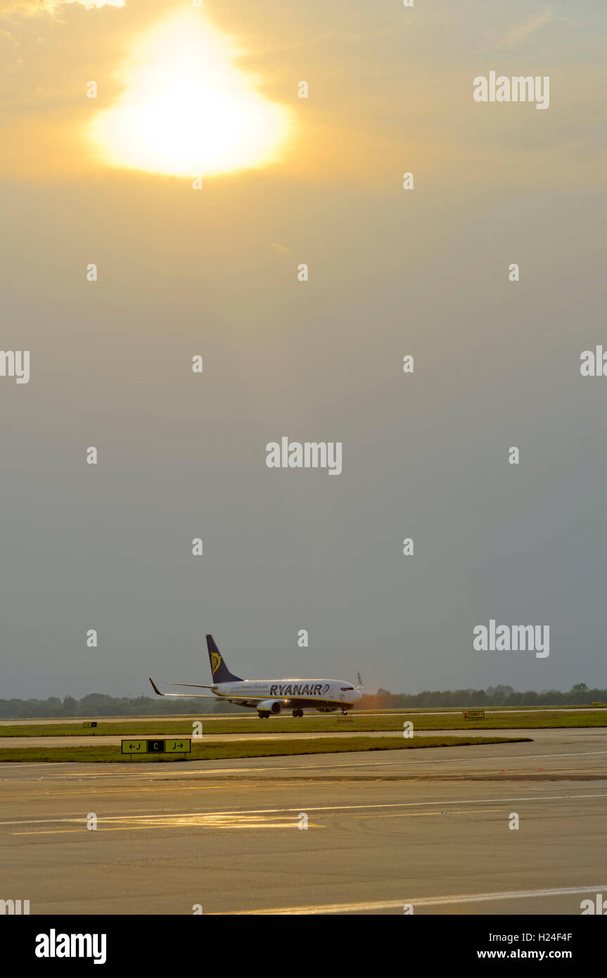 RYAN AIR PLANE ON THE RUNWAY AT STANSTED AIRPORT - Stock Image