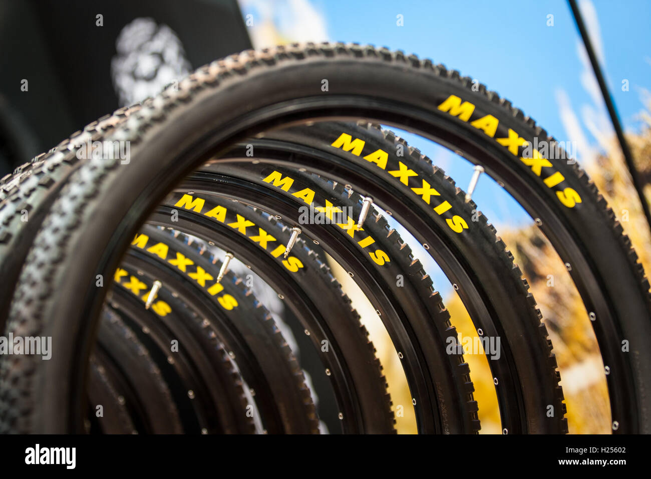Birmingham, UK 24th Sep, 2016 Birmingham, UK 24th Sep, 2016 Maxxis bike tyres on display on their stand Credit: - Stock Image