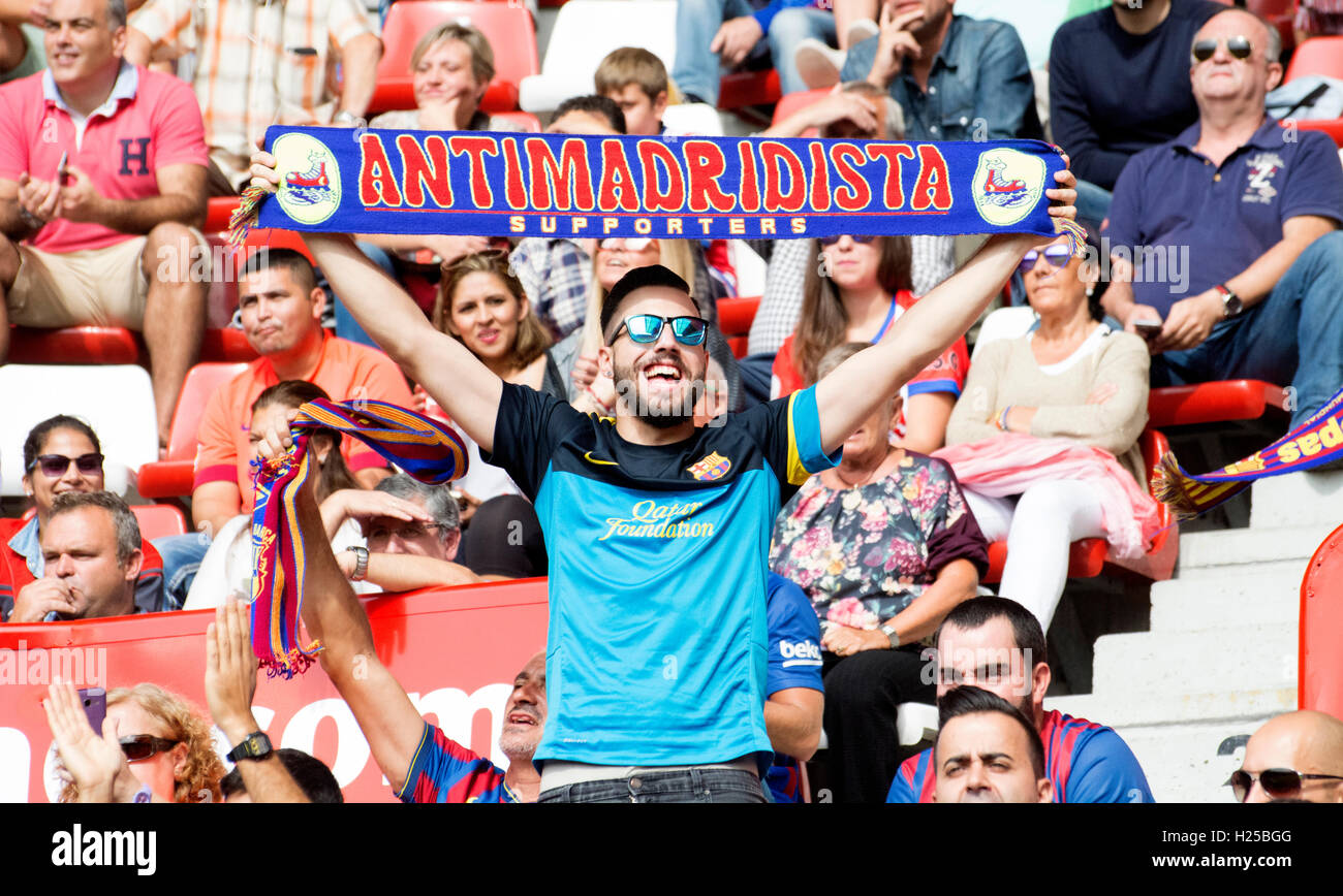 Gijon, Spain. 24th September, 2016. A FC Barcelona's supporter with a scarf during the football match of sixth - Stock Image
