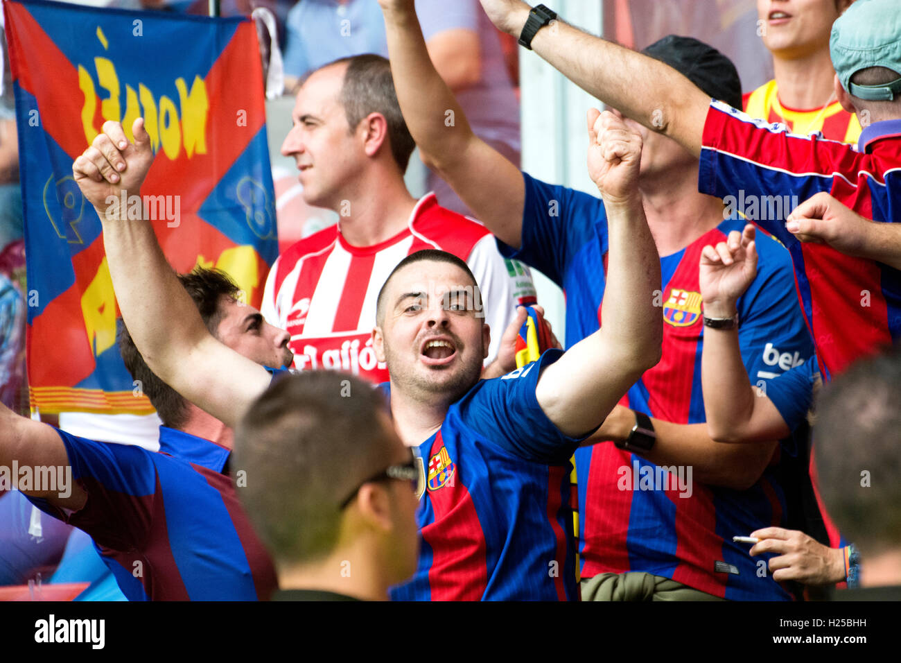 Gijon, Spain. 24th September, 2016. Fc Barcelona's supporters celebrate the first goal of their team during - Stock Image