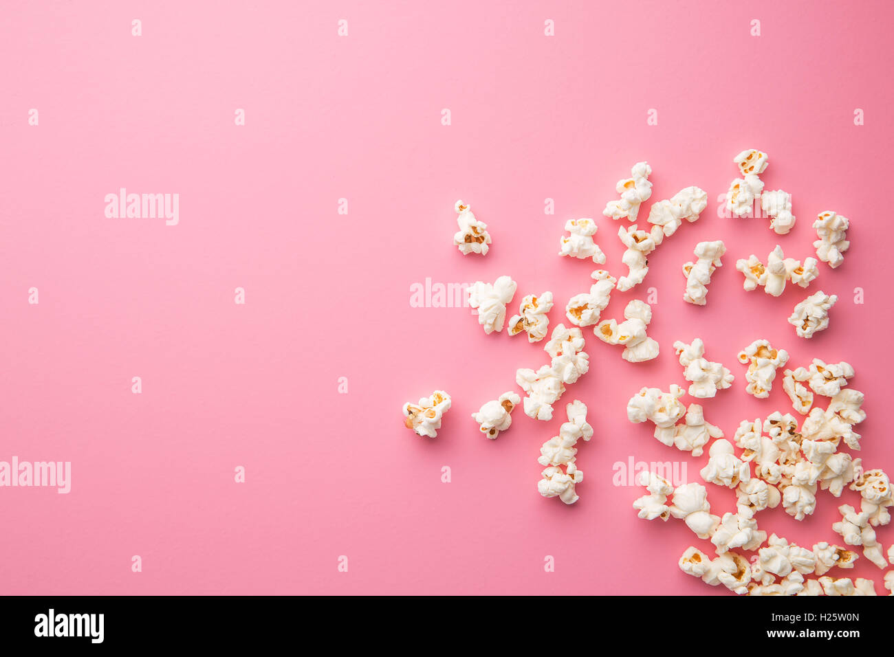 The popcorn on pink background. Stock Photo